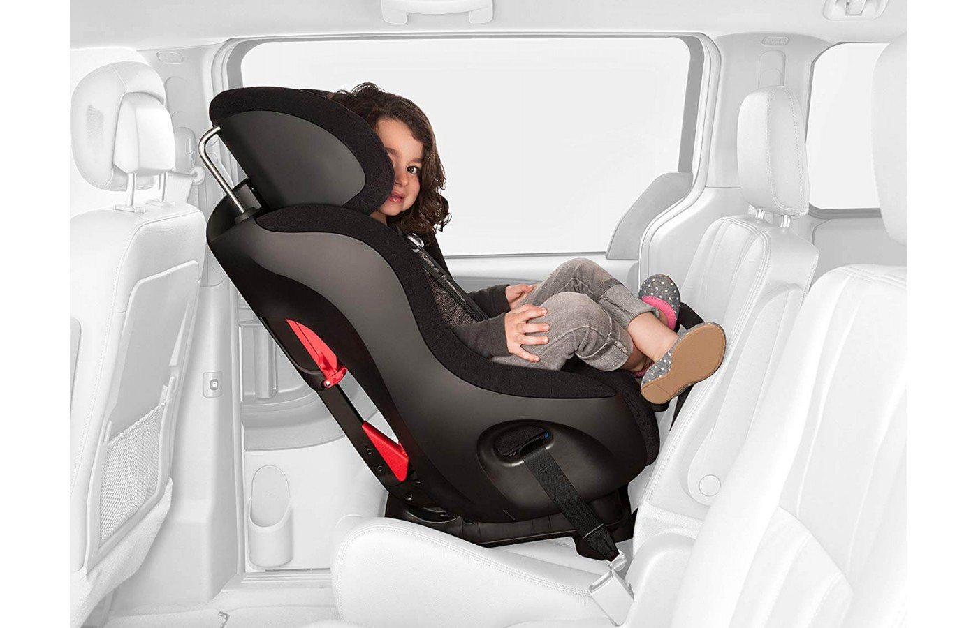 The Clek Fllo is compact and 3 can fit in the backseat.