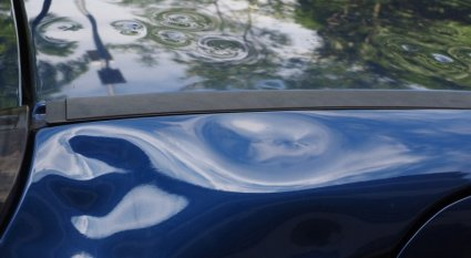 An in depth guide to tackle a car dent repair at home.